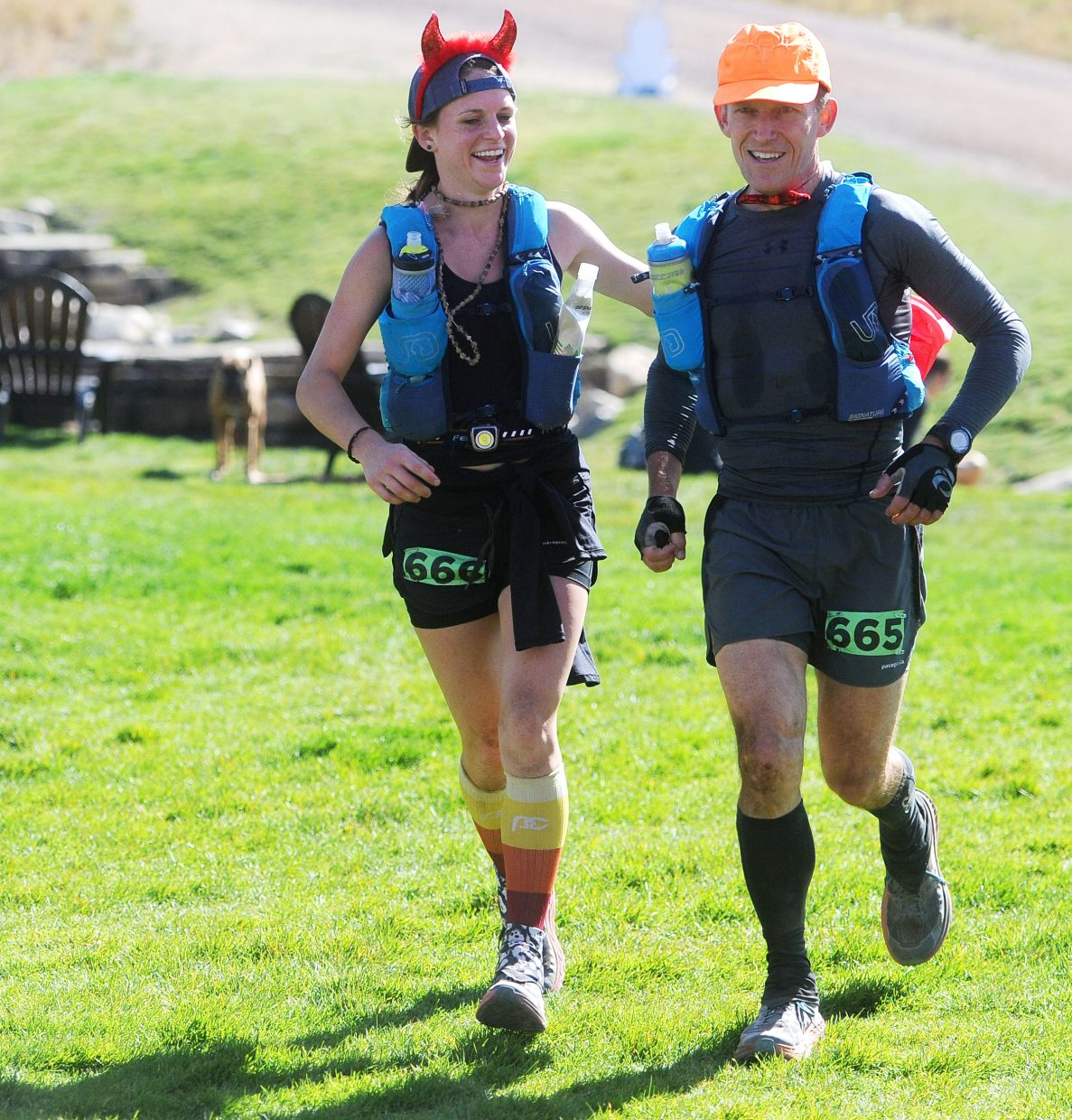 Brianna, left and her father, Bill Tidd prepare to cross the finish line at the Steamboat Springs Run Rabbit Run 100 on Saturday, Sept. 15 in the tortoise division.