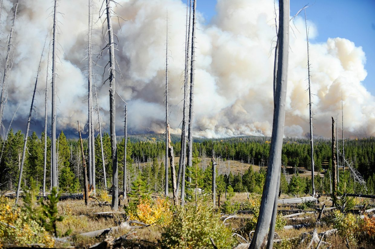 The Silver Creek Fire burns Sept. 12 behind the the Green Creek burn scar.