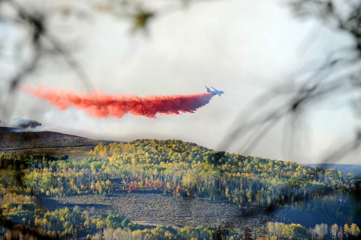 A tanker drops retardant Thursday on the perimeter of the Silver Creek Fire.