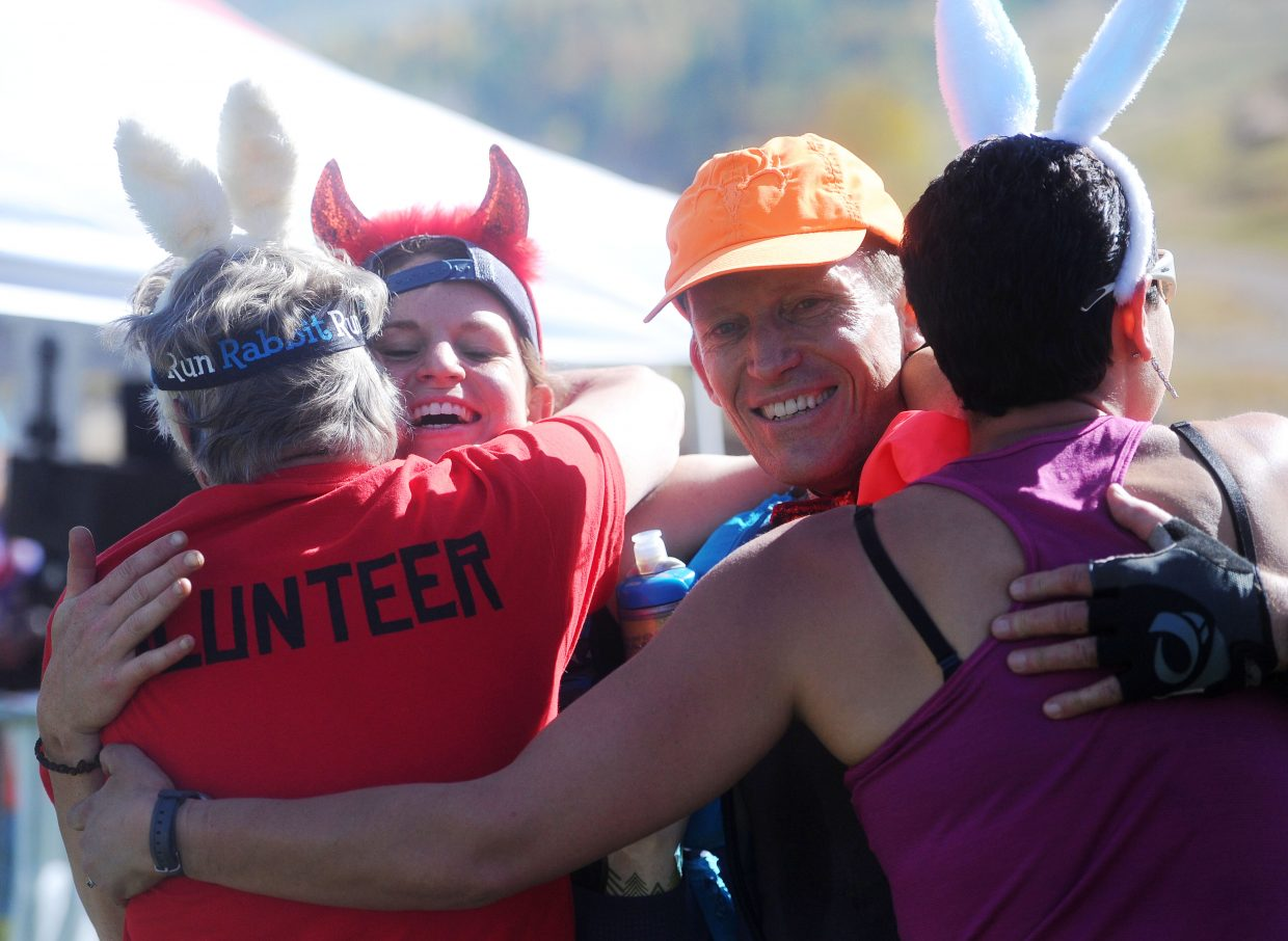 Brianna Tidd embraces race director Fred Abramowitz, left, while Bill Tidd embraces race director Brady Worster after finishing the Steamboat Springs Run Rabbit Run 100-mile race.