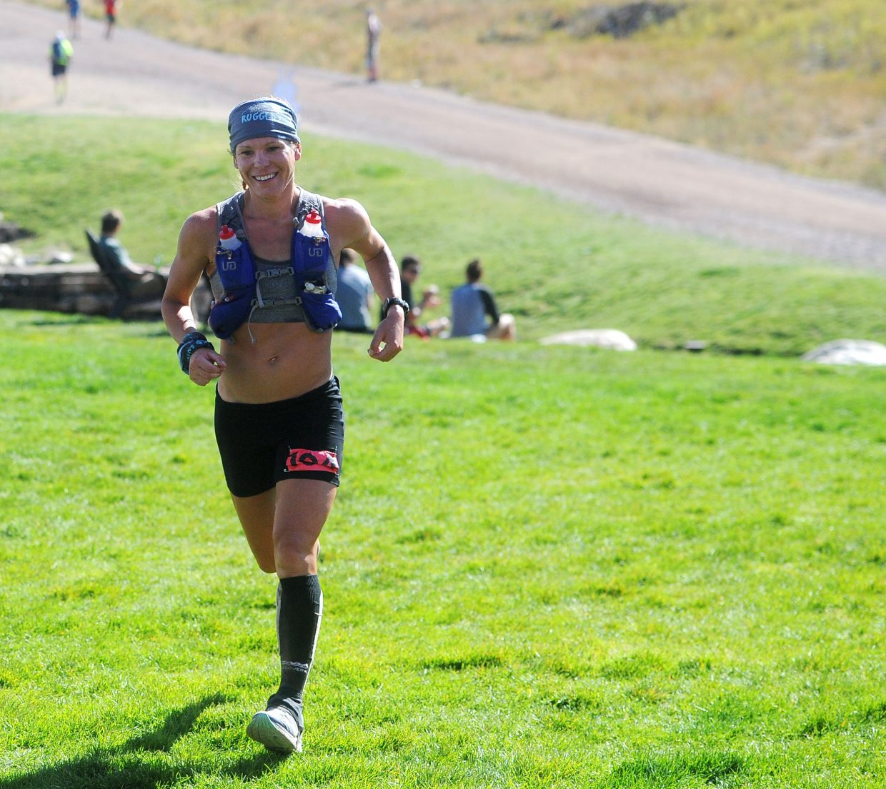 Michele Yates from Conifer runs to the finish to take first place in the women's hare division of the Steamboat Springs Run Rabbit Run 100 with a time of 22 hours, 33 minutes and 54 seconds.