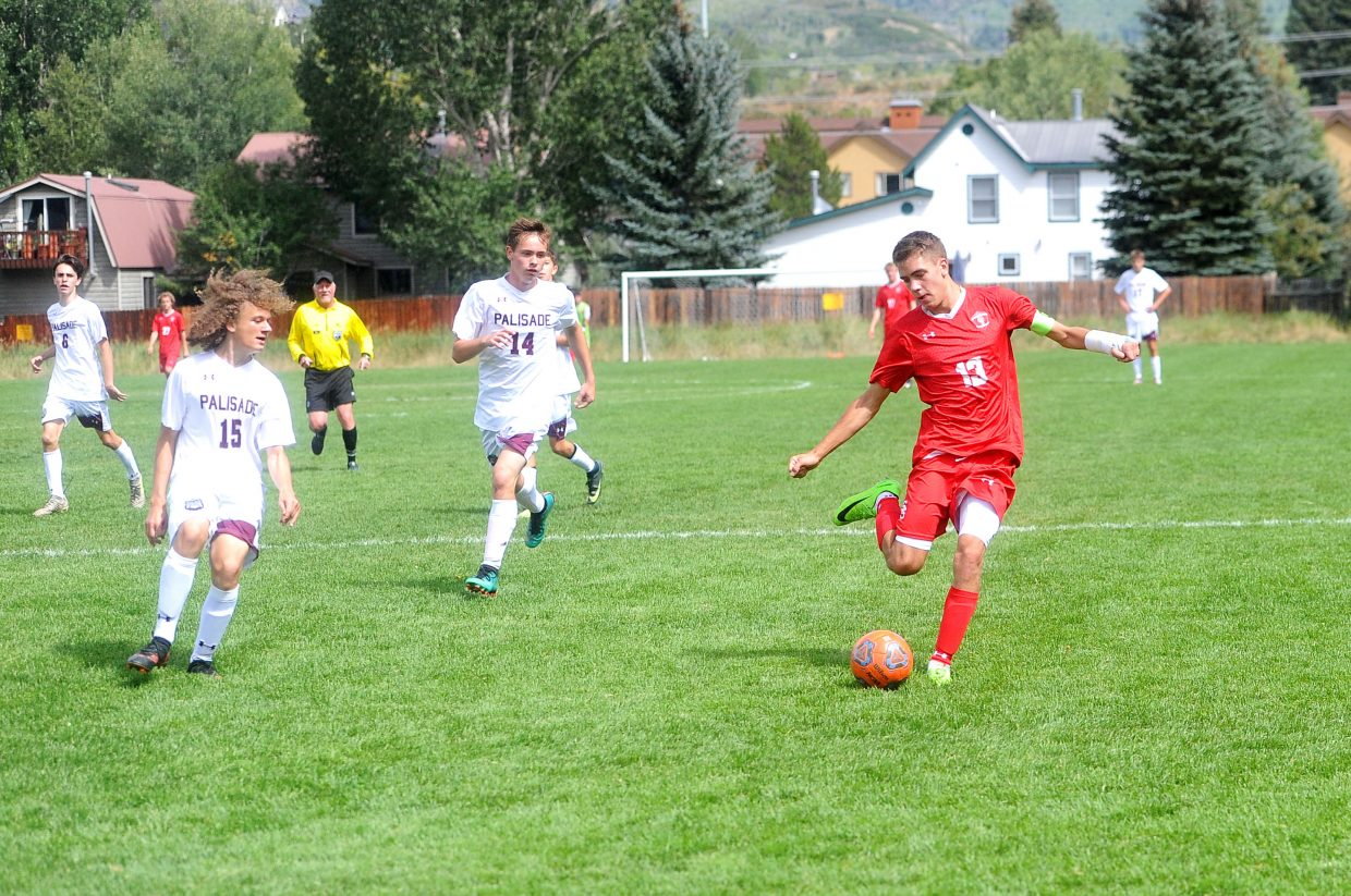 Steamboat Springs High School senior Murphy Bohlmann escapes a defender in Saturday's game against Palisade on Dudley Field. Steamboat went on to win the game 11-1. Bohlmann had three goals in the contest.