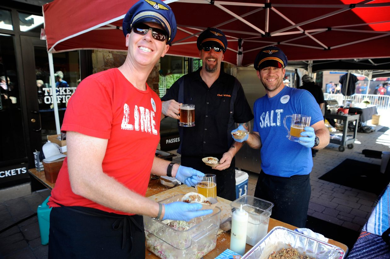 Rex's Family of Restaurants employees, from left, Nick Sharp, Chad Whitaker and Jeff Snook take a break from serving during the brisket competition.