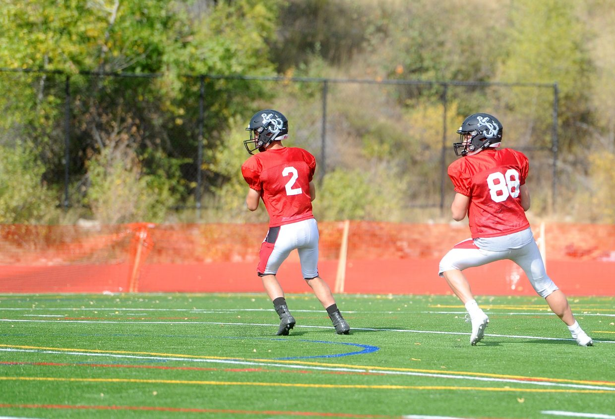 Junior Diego Effinger (left) and senior Drew Bowers (right) practice footwork for passing at practice on Wednesday, Sept. 5.