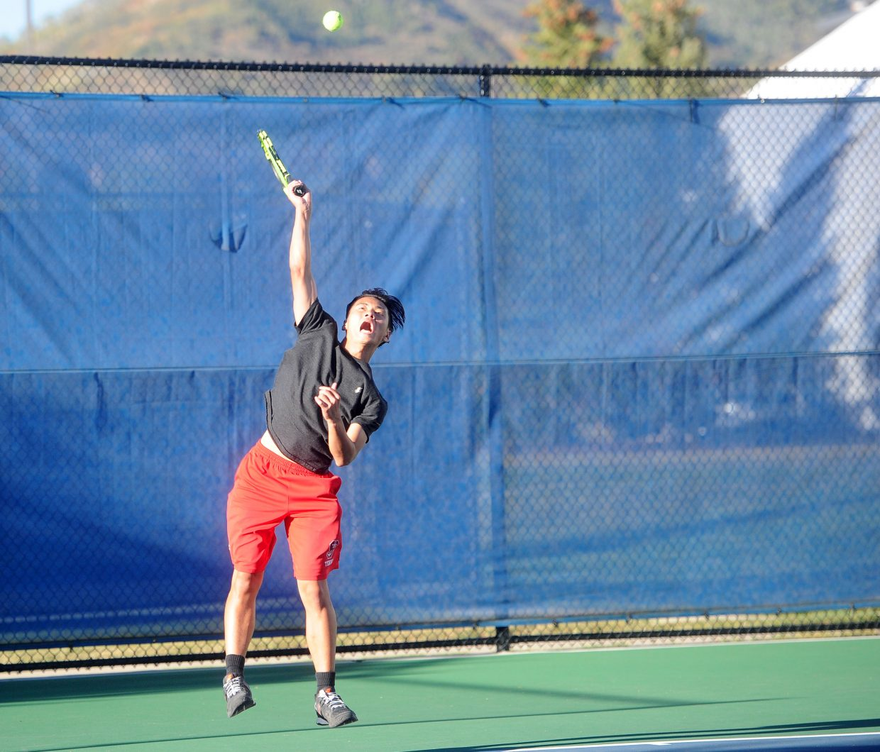 Roy Lundeen knocks a serve against Ethan Paulus in the challenge match for No. 2 singles on the Steamboat Springs High School varsity team on Wednesday, Sept. 12.