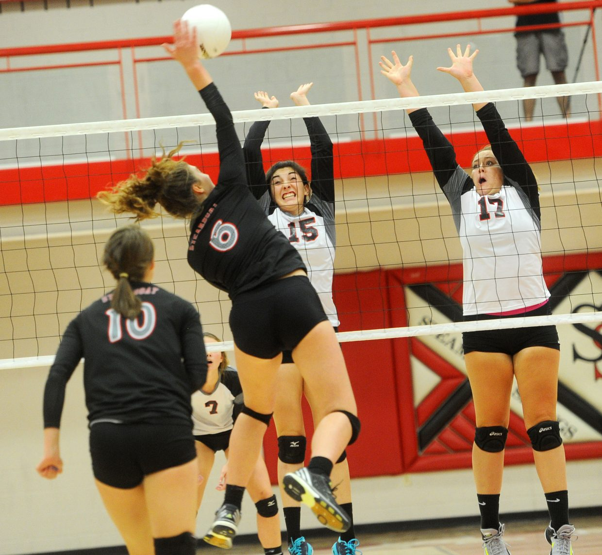 Steamboat Springs High School senior Sophie Walentiny hits between the block against Eagle Valley at Steamboat Springs High School on Thursday, Sept. 13.