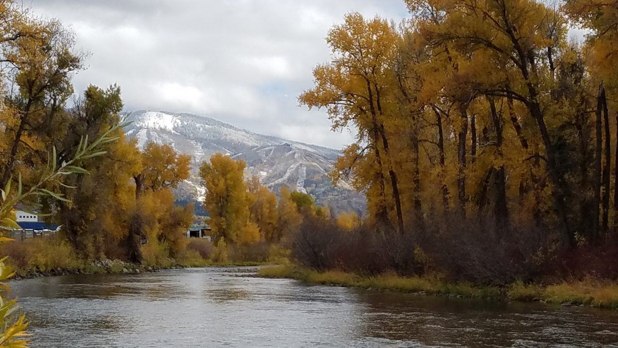 Snow is visible on Mount Werner from the Yampa River Core Trail.
