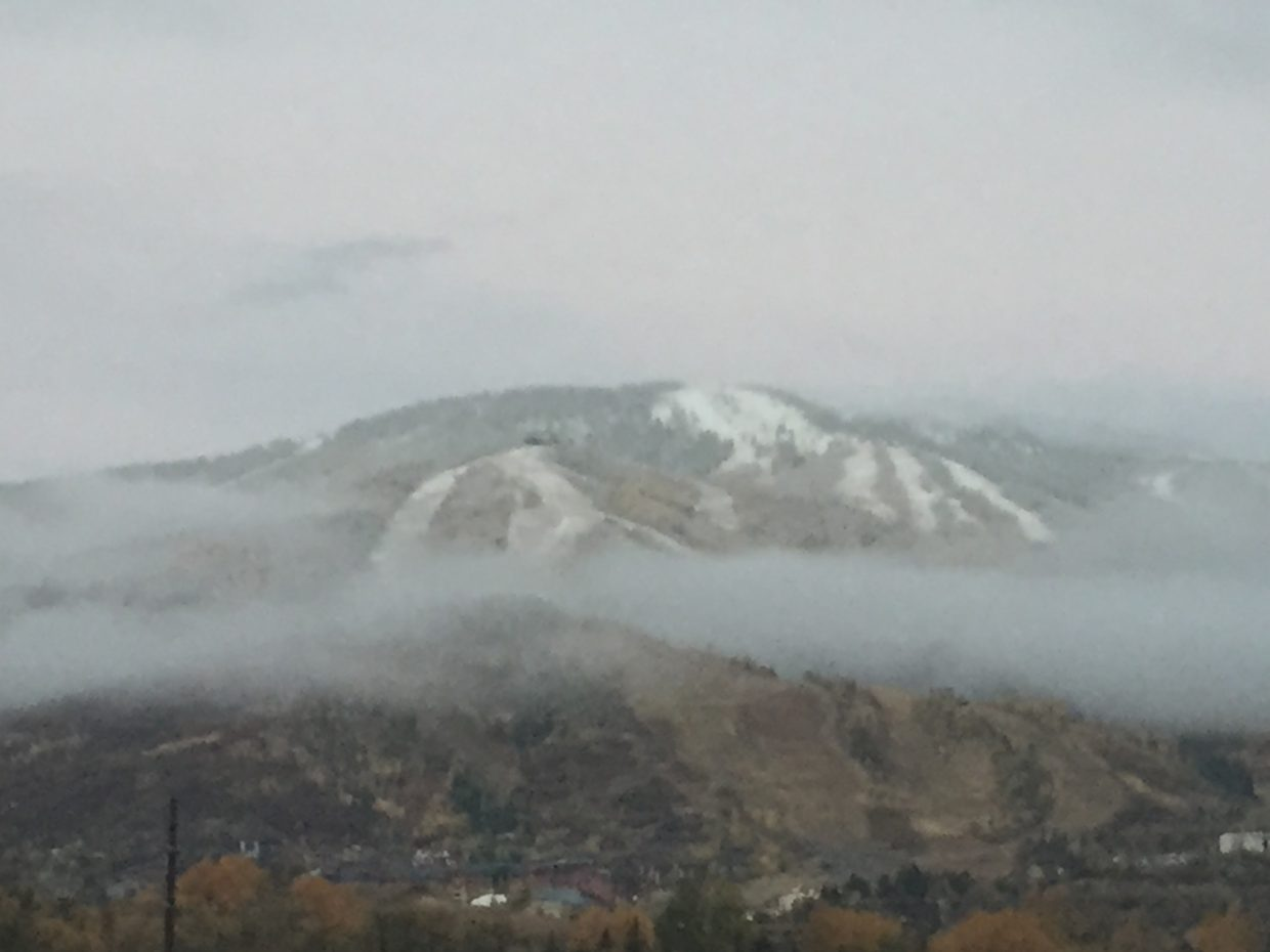 Snow is visible on Mount Werner.