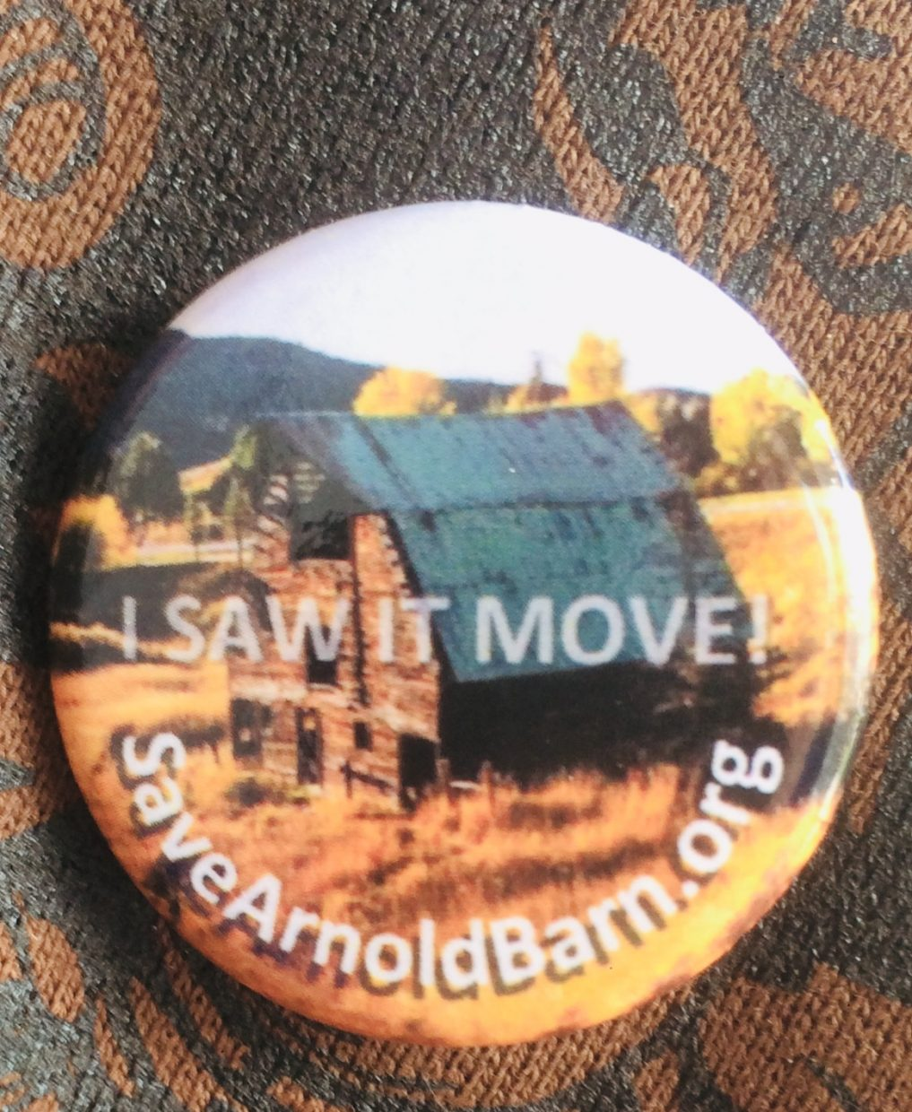 A shot of the button handed out for the people who watched the Arnold Barn make its move.
