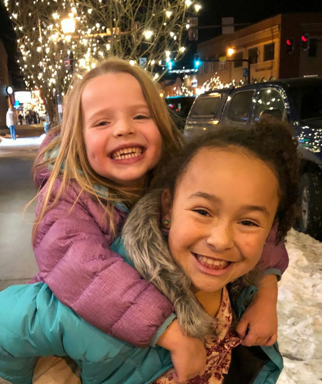 Two girls enjoy time in downtown Steamboat Springs, which is slowly being decorated for the winter season.