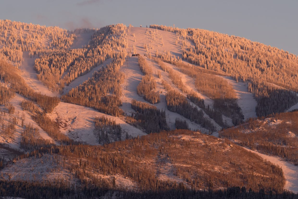 The sun sets on Mount Werner as seen from Four Points.