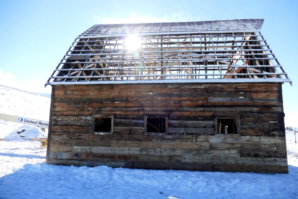 Here is the historic Arnold Barn in Steamboat Springs, recently moved to its new location. It is without a roof this morning. Berlet Roofing is donating a new roof to the barn and it will be installed today.