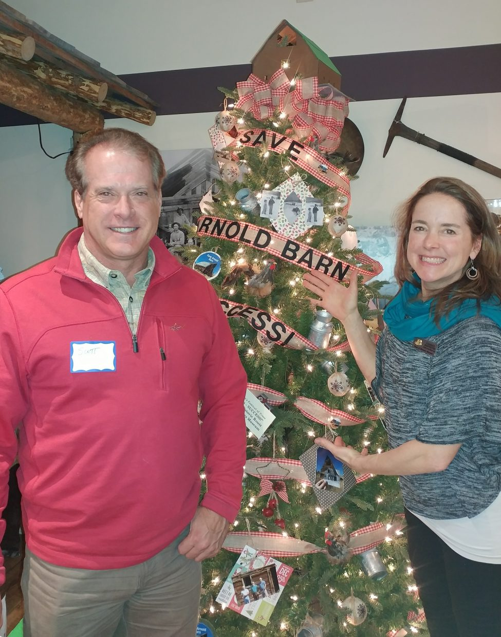 For over 20 years, Conroy Moving and Storage has been donating trucks and labor to deliver trees in support of the Tread of Pioneer Museum's Festival of Trees fundraiser. Scott Lewer, of Conroy Moving and Storage Inc., and Candice Bannister, the museum's executive director, stand next to the Arnold Barn Christmas tree. Sponsored trees were created and designed for the philanthropic benefit of the museum, and on Tuesday, 28 trees were delivered to the businesses and individuals who purchased them. All proceeds benefit the museum.