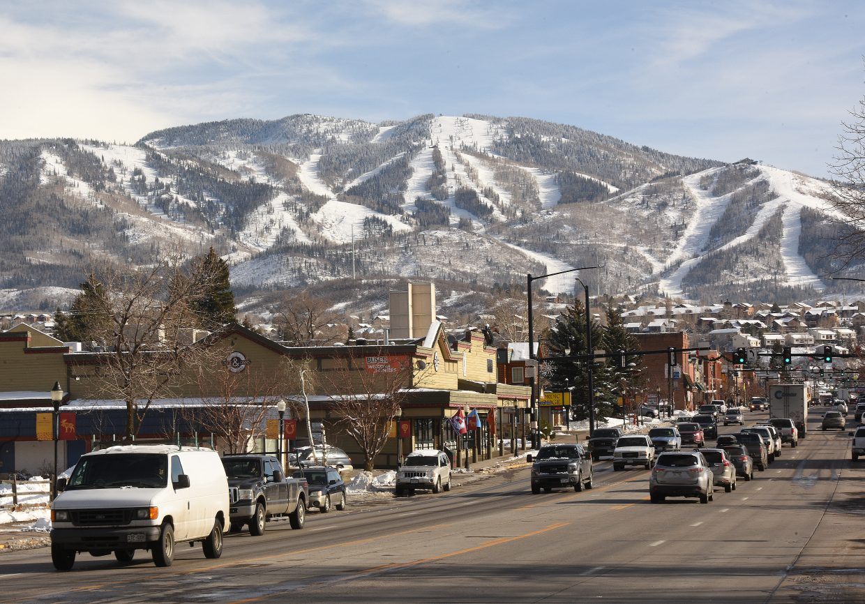 The snow-covered slopes of Mount Werner make the post-card perfect backdrop for downtown Steamboat Springs as traffic makes its way along Lincoln Avenue Tuesday afternoon.