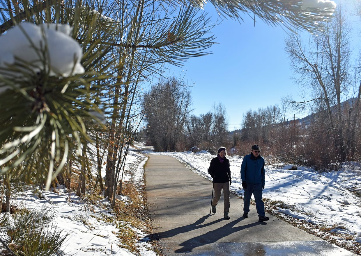 Ann and Ed DeCicco enjoy an afternoon walk on the Yampa River Core Trail near Dr. Rich Weiss Park on Sunday. After a snowy Saturday, many Yampa Valley residents enjoyed a Sunday full of sunshine.