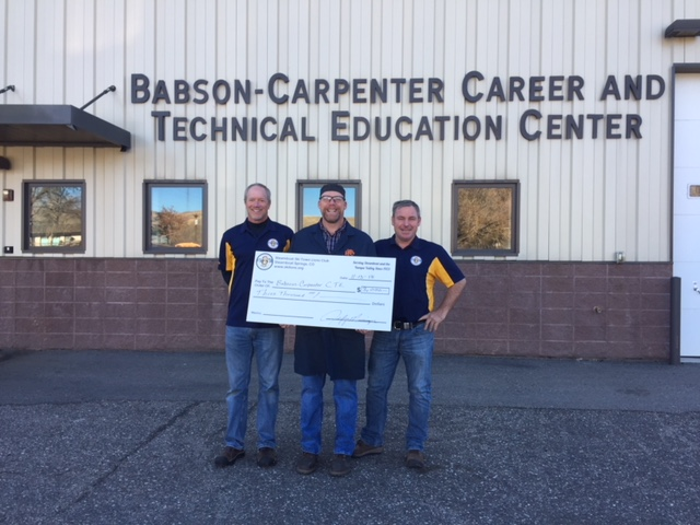 Ed Mumm and Jeff Messinger with the Steamboat Ski Town Lions Club present a check to Kevin Kleckler with Babson-Carpenter Career and Tech Ed Center.