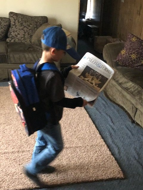 Kane gets his news before school by reading the Steamboat Pilot & Today.
