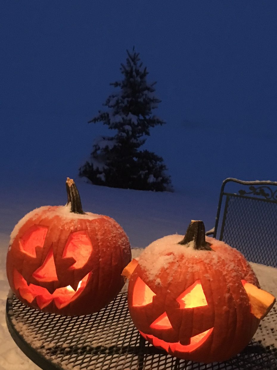 Snow covers up Halloween pumpkins, officially saying fall is over.