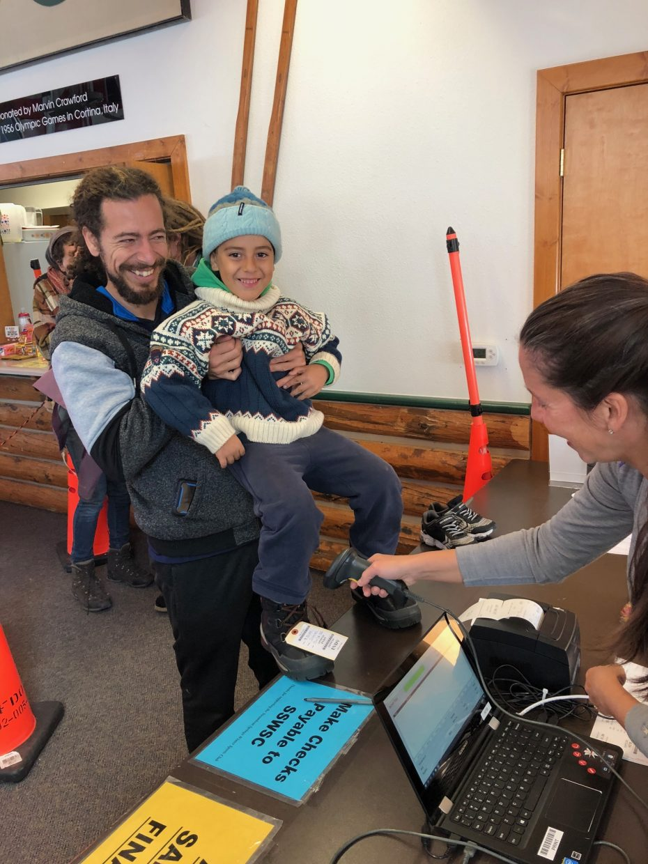 A little shopper at the Steamboat Springs Winter Sports Club Ski Swap at Howelsen Hill couldn't wait to wear his new boats.