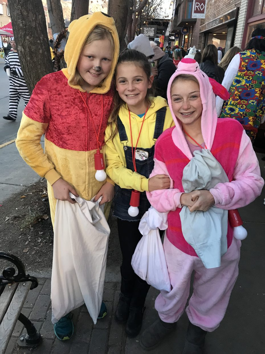 Pooh, a minion and Piglet all meet during the Halloween Stroll.