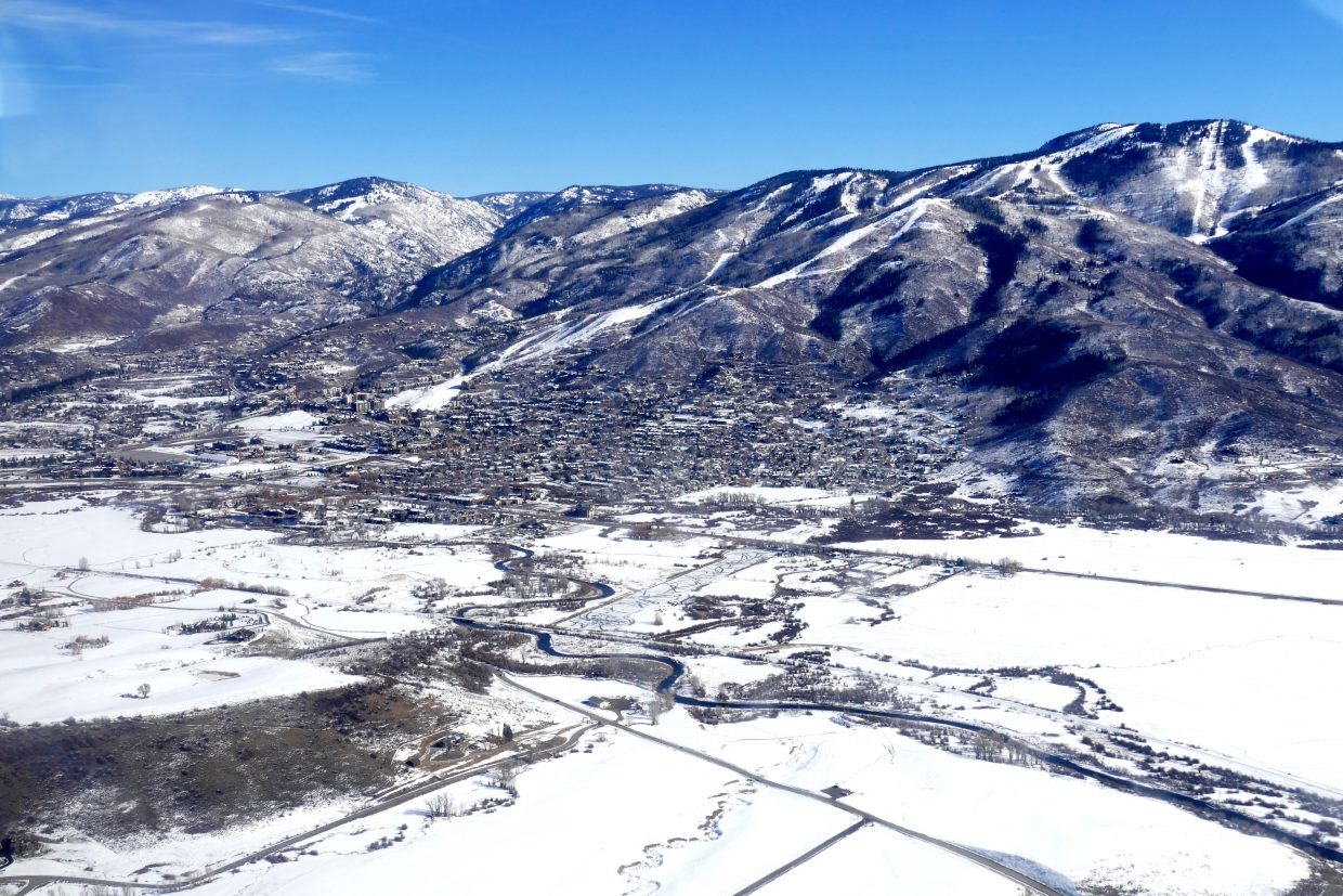 I was invited to fly over the Yampa Valley today with EcoFlight out of Aspen. Pictured is Steamboat with the snowy slopes of the ski area in the background.