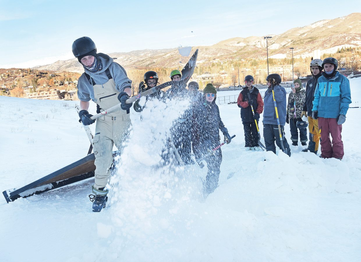 Axel Kobach and members of the Steamboat Spring Winter Sports Club freeskiing team work to set up the terrain park at Howelsen Hill on Tuesday afternoon. Winter sports athletes in Steamboat are eager to get back on the slopes as winter quickly approaches.
