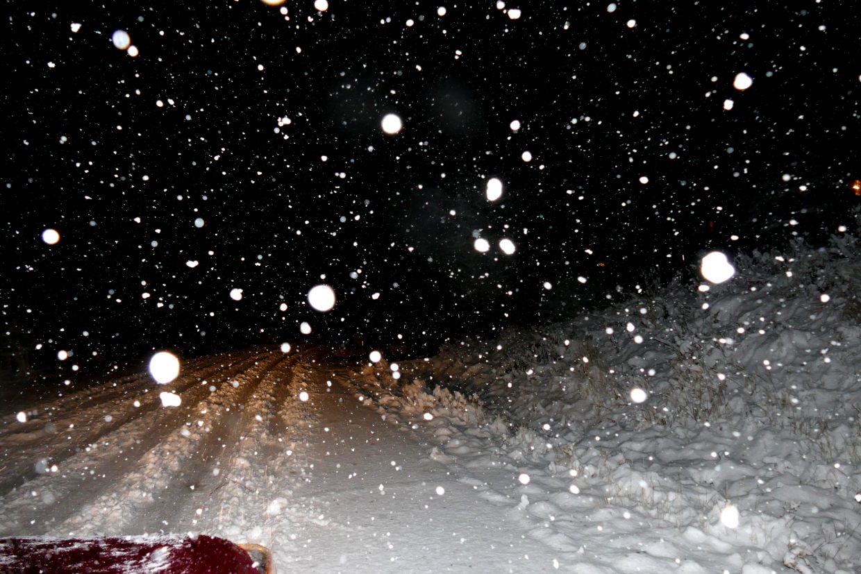 Snow falls hard along the roads as a storm passes through Routt County.