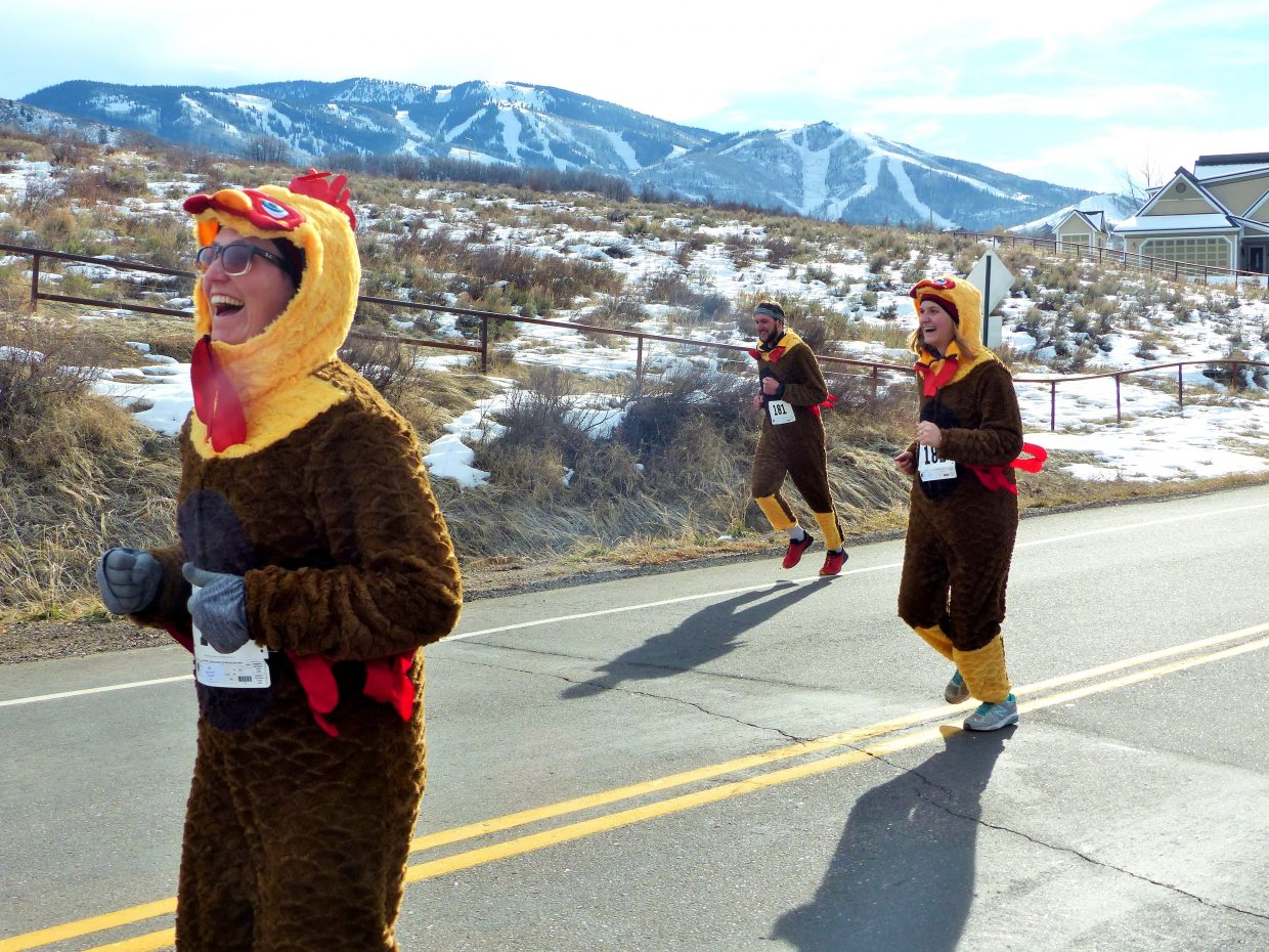 Runner dressed as turkeys race in the 5-kilometer Turkey Trot, benefitting the Steamboat Springs High School track and cross country teams.