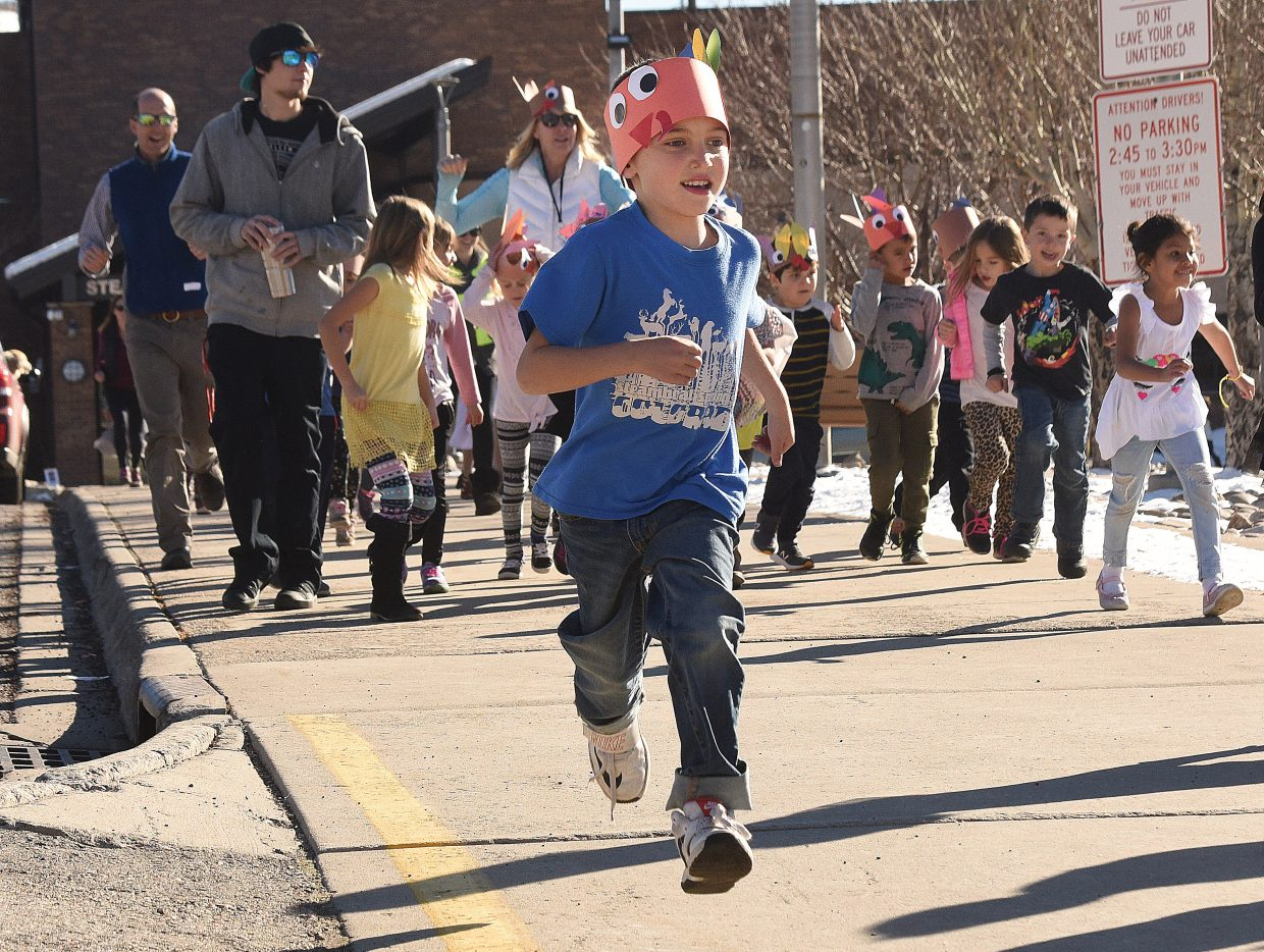 Strawberry Park Elementary School first grader Lake Schendri makes his way around the parking lot at the Strawberry Park campus Tuesday afternoon as part of the school's annual Turkey Trot.  Students burned off a bit of excess energy as part of the tradition, which takes place on the final day before the Thanksgiving Break.