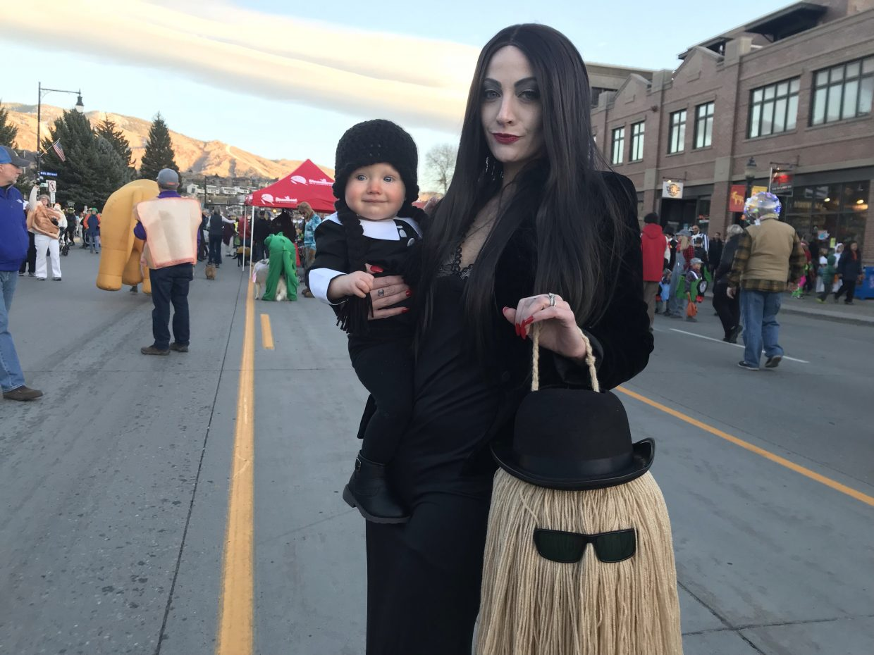 The Addams family makes it way down the Halloween Stroll.