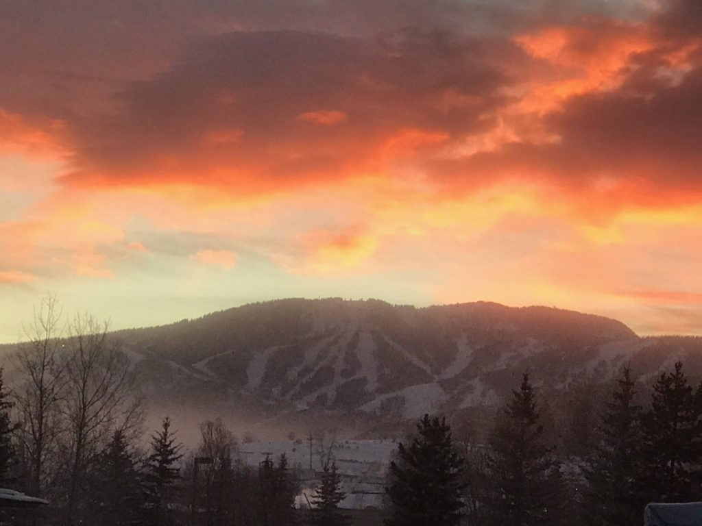 The sun rises over Mount Werner.