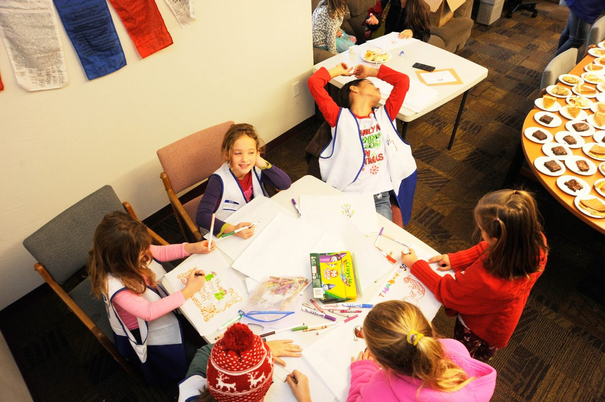 Volunteers decorate placemats Thursday for the Routt County United Way Community Thanksgiving Dinner.