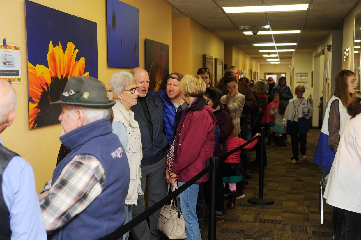 People stand in line for Thursday's Routt County United Way Community Thanksgiving Dinner.