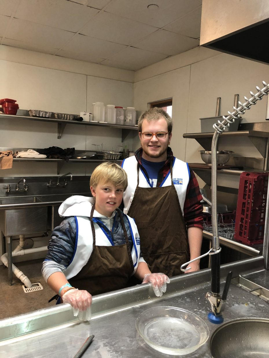 Jack and Dietze Gibson work at the Community Center on Thanksgiving Day for Routt County United Way.