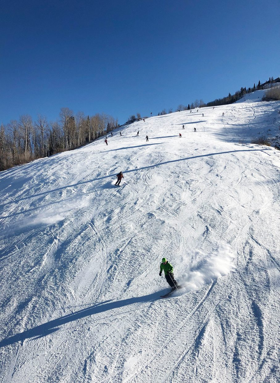 Skiers cruise down Heavenly Daze on Wednesday during Opening Day at Steamboat Resort.