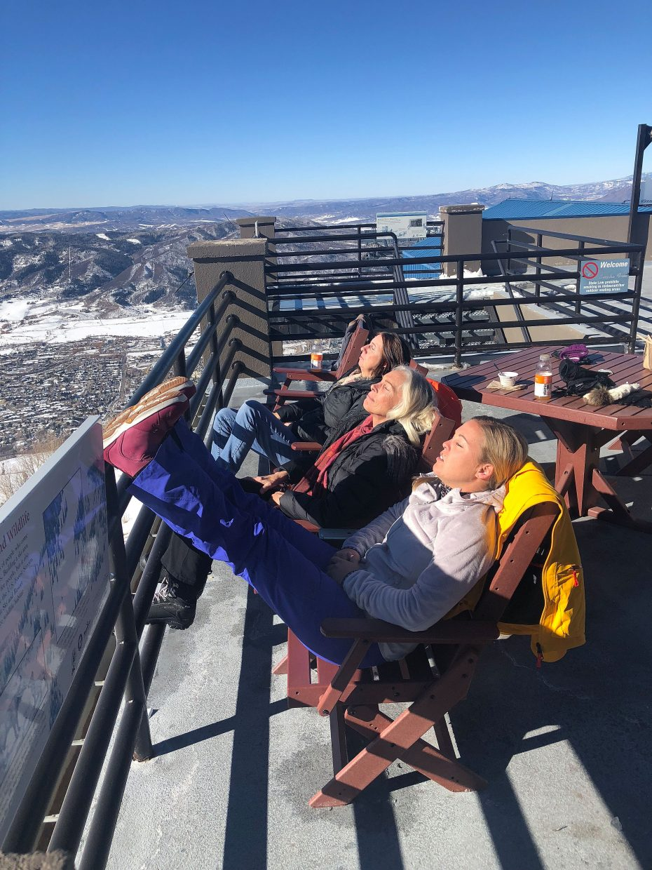 Steamboat Resort visitors, from front, Nicole Benz, Holly Collamer and Brenda Benz soak in the sun at Thunderhead Lodge on Wednesday during Opening Day at Steamboat Resort.