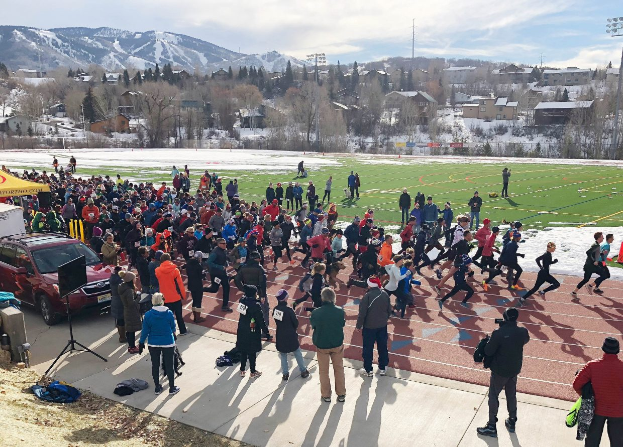 Runners leave the starting line of the Steamboat Springs Turkey Trot on Thursday at Steamboat Springs High School.  Screen reader support enabled.