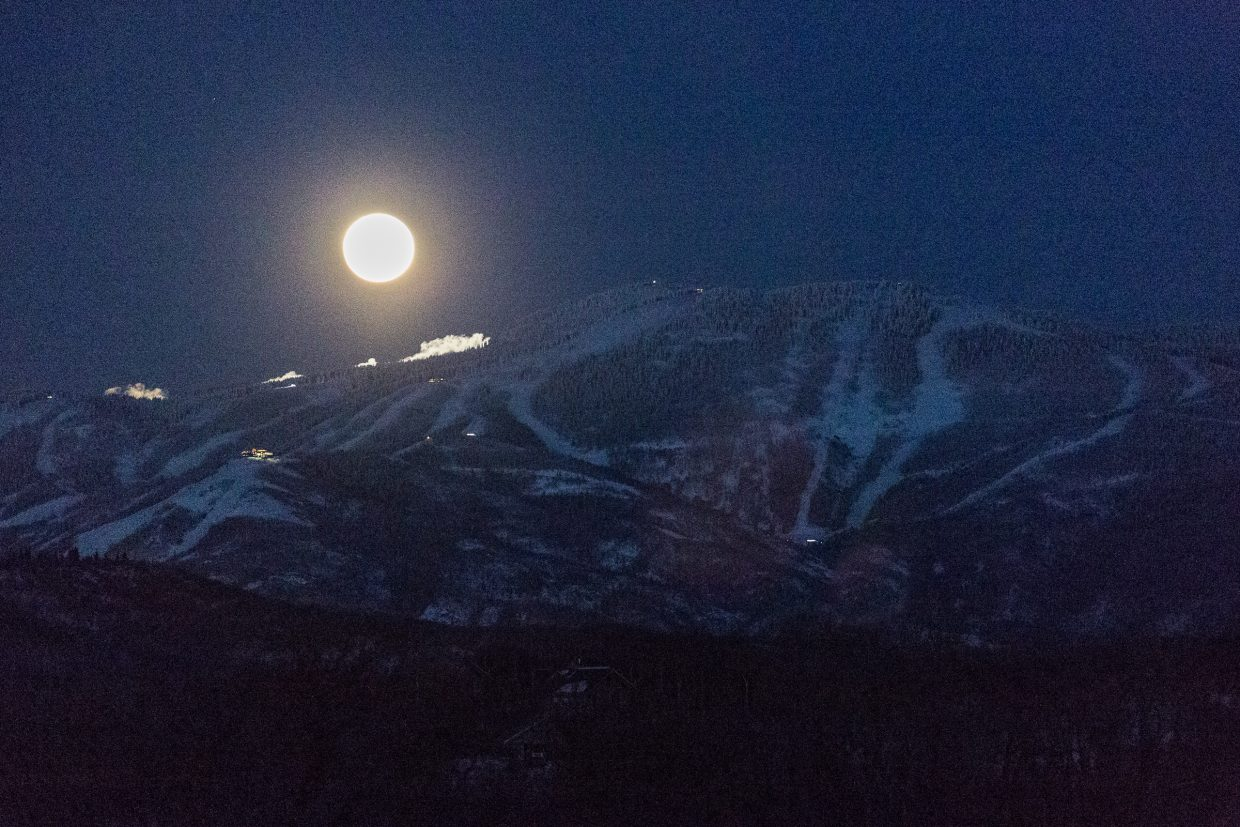 A full moon rises over Mount Werner in Steamboat Springs.