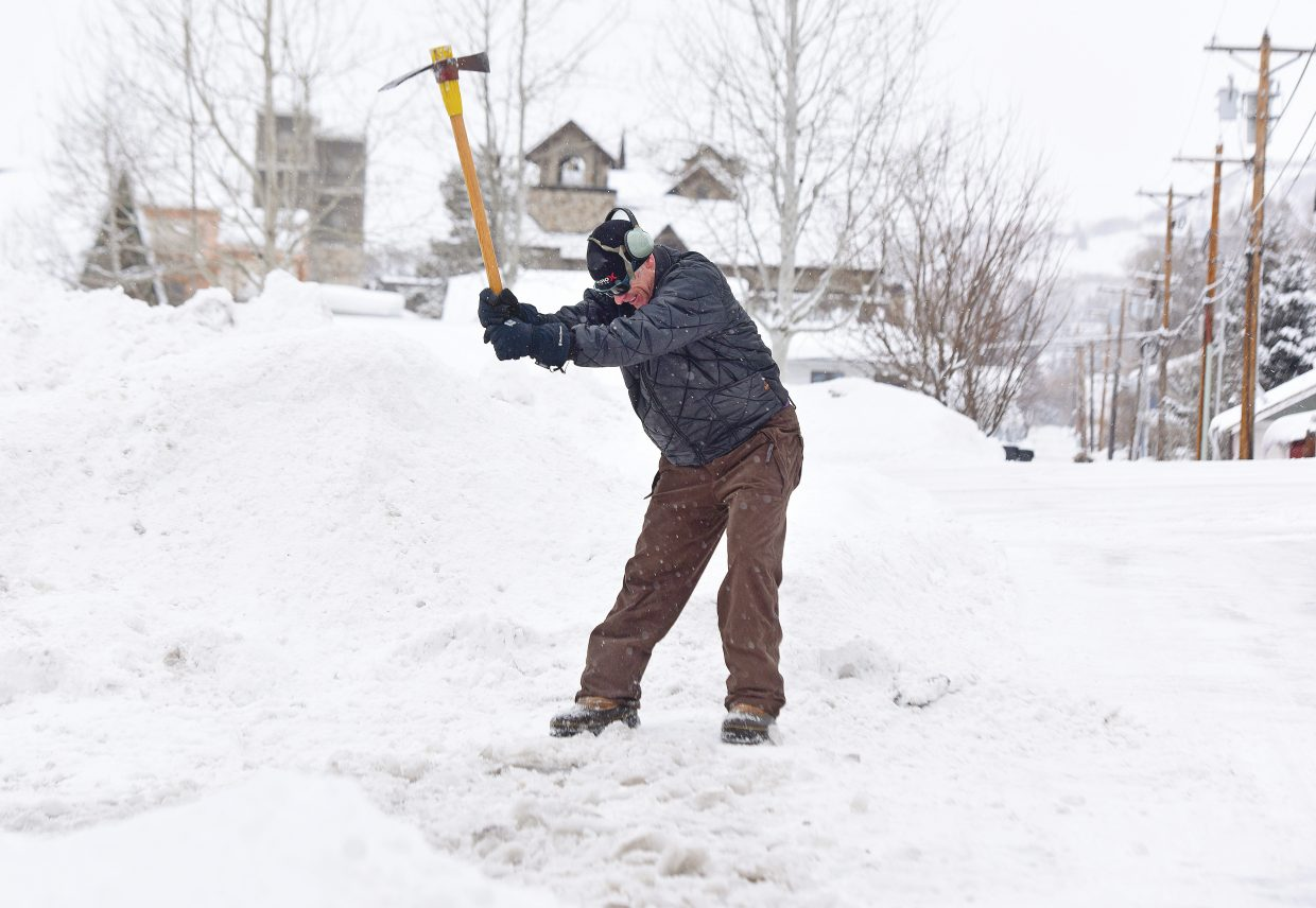 Jon Freckleton uses a mattock to chip away at a icy ridge the formed at the end of the driveway in old town. The final day of 2018 began with snow and cold temperatures. Just like those bumps at the end of the driveway the weather is pretty much what is expected at the end of December in Steamboat Springs, Colorado.