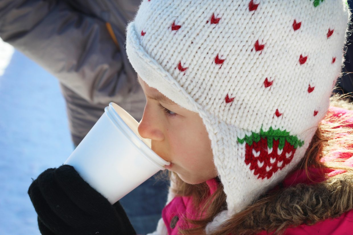 Andie Van Kuren sips hot chocolate and thinks about her holiday wish list as she waits in line to meet Santa Claus at the Holiday Festival at Steamboat Resort.