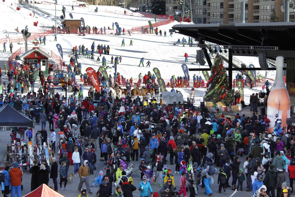 A large crowd gathers at the 2018 Holiday Festival in Gondola Square on Sunday.