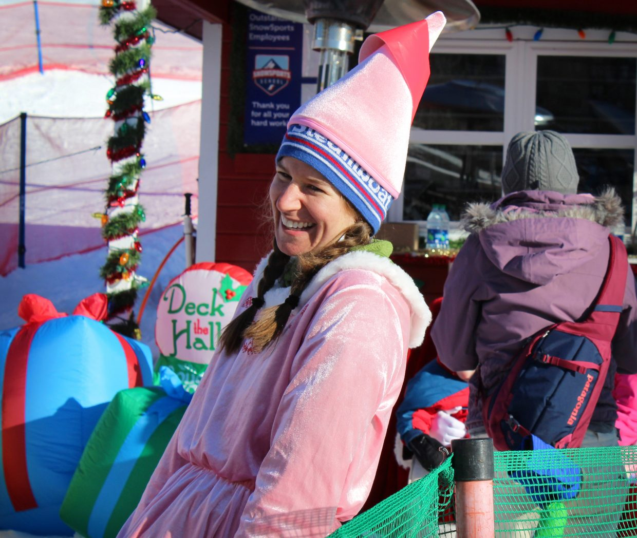 One of Santa's elves laughs while speaking with children patiently awaiting their chance to meet Santa Claus at the Holiday Festival at Steamboat Resort.