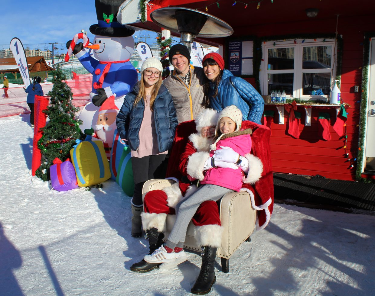 A family visiting from Texas poses with Santa Claus at the base area at Steamboat Resort during the Holiday Festival on Sunday. Pictured, from left, are Avy Shaw, Zack Ratkovich, Mindy Van Kuren, Andie Van Kuren and, of course, Santa Claus.