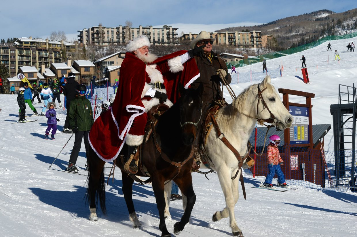 Santa rides in on a horse instead of his trusty reindeer for the Holiday Festival at Steamboat Resort.