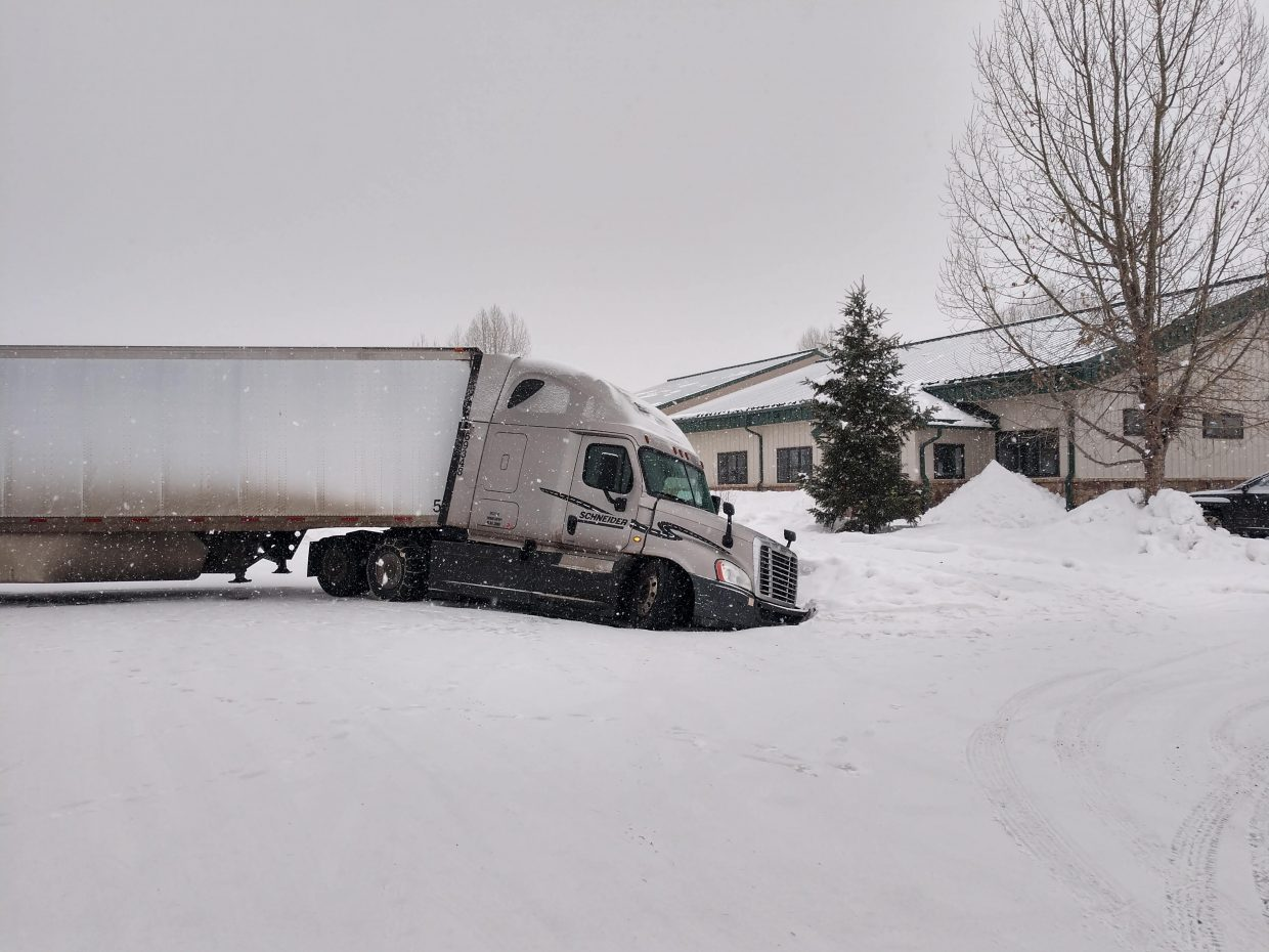 An eighteen wheeler goes off the road and into a ditch as snow hit Steamboat Springs.