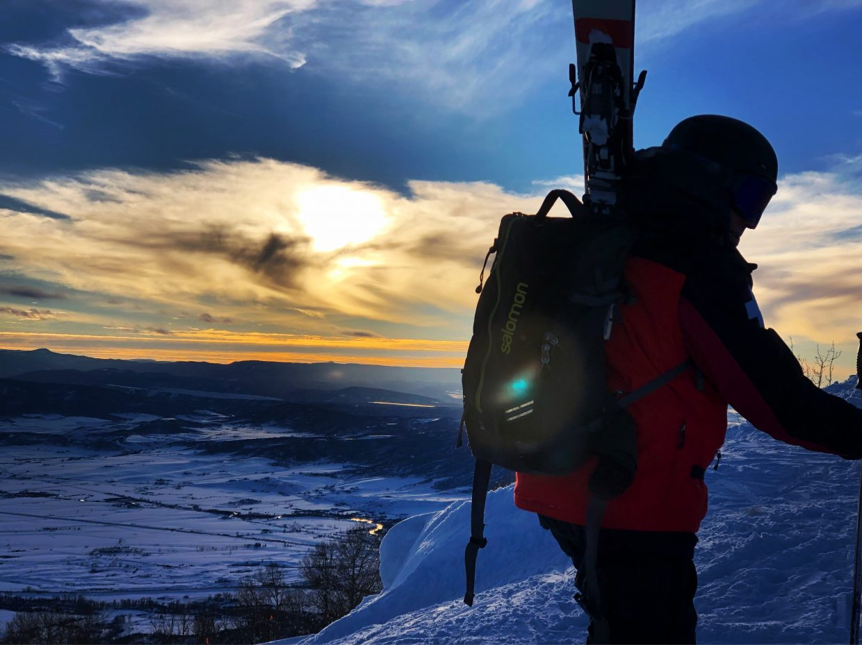 A skier heads up Steamboat Resort for one last run.
