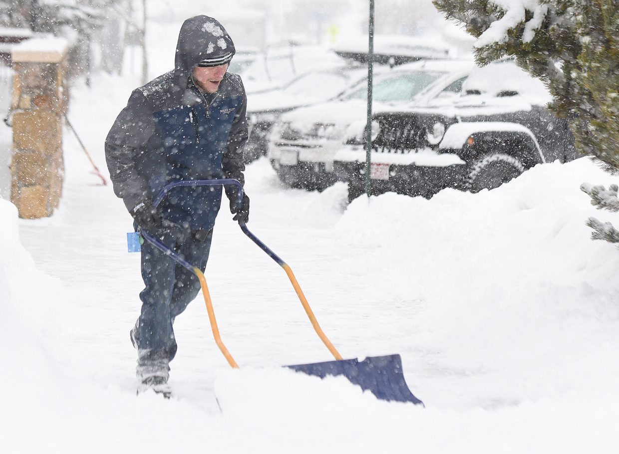 Torian Plum Resort employee Bobby Reed shovels snow from the sidewalks in Ski Time Square Wednesday. Steamboat saw periods of heavy snow as a storm moved through the area.