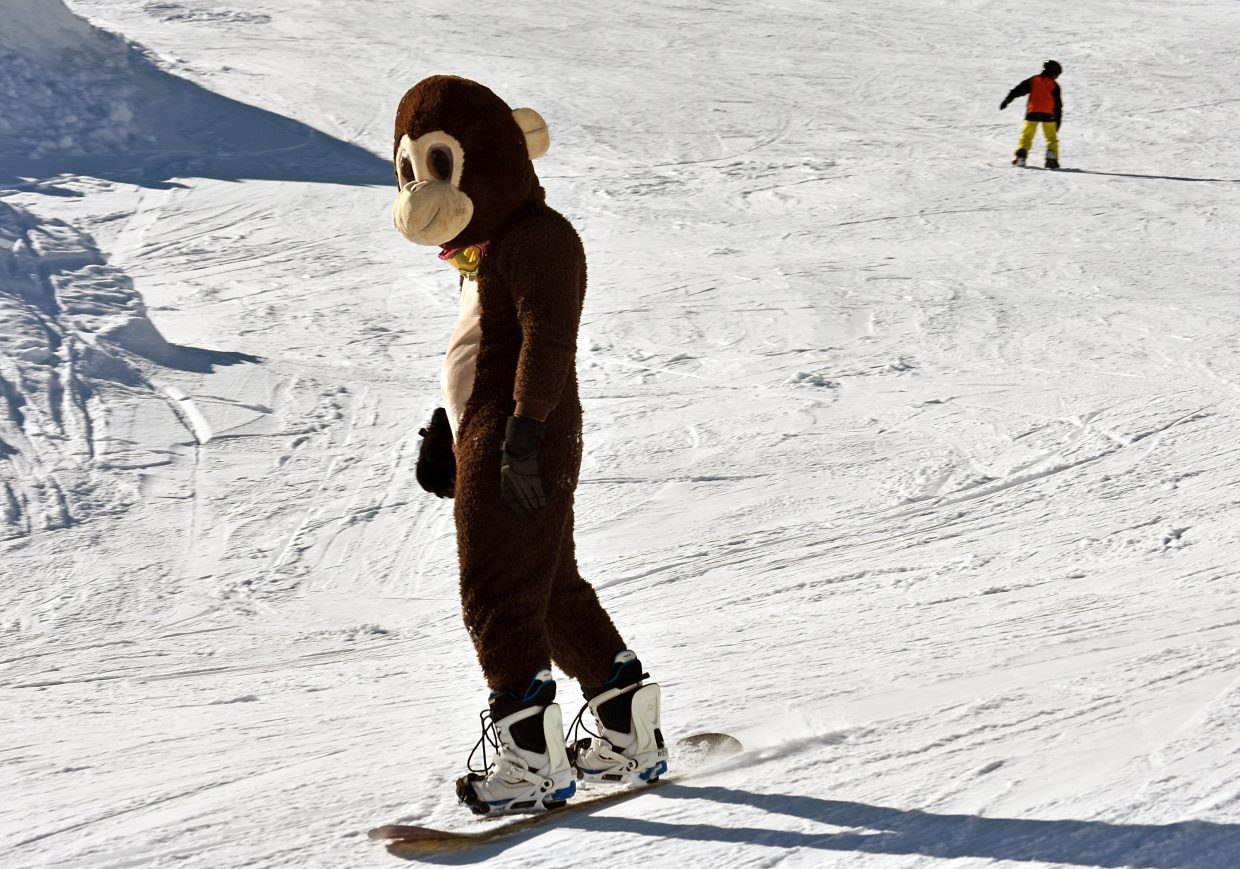 Justin Dunn, dressed as a monkey, rides down Pony Land on Howelsen Hill on Sunday afternoon.