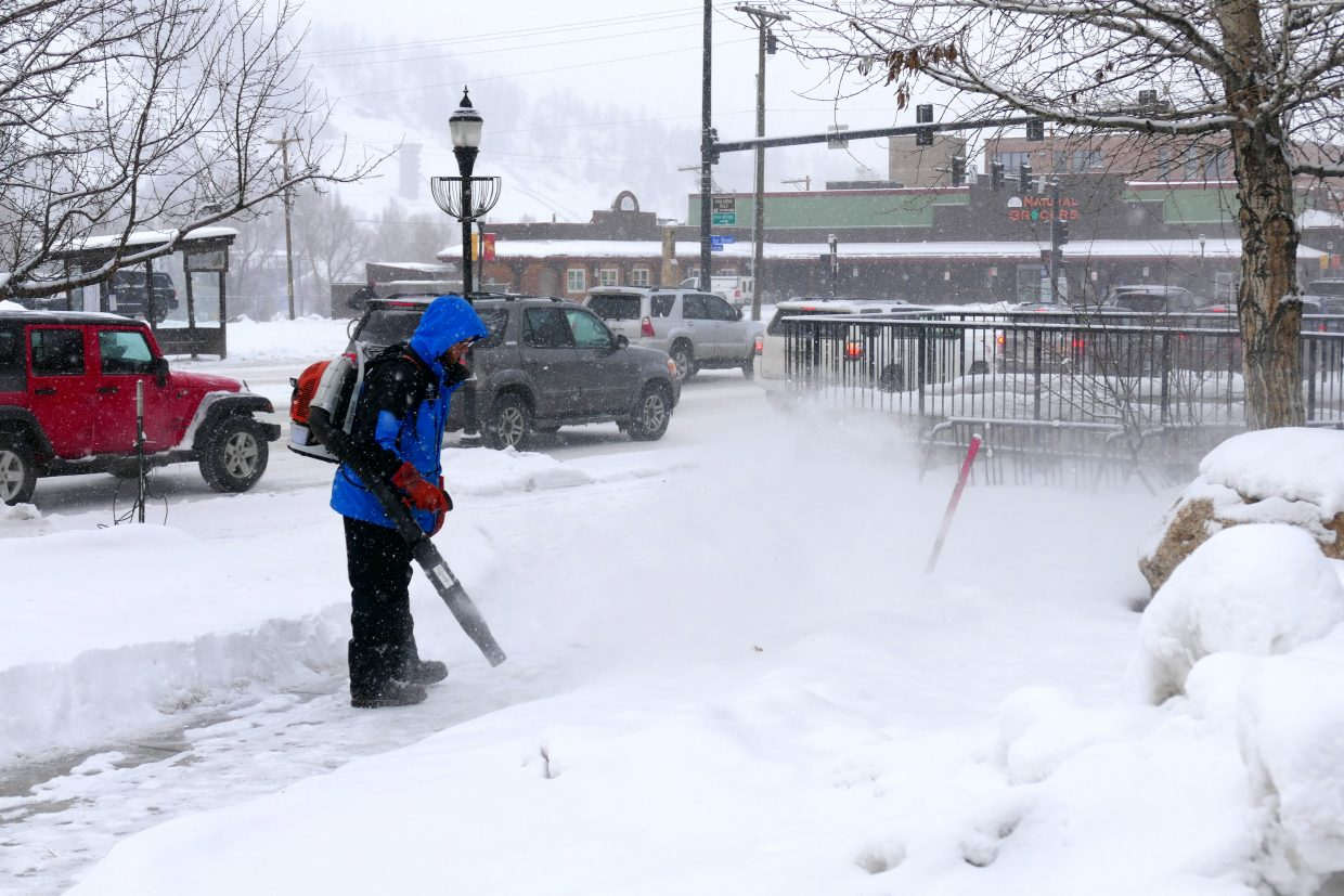 Someone blowing the snow off the sidewalk in Steamboat. This is along Lincoln Avenue, which is also Highway 40. It's a cold and snowy day here.