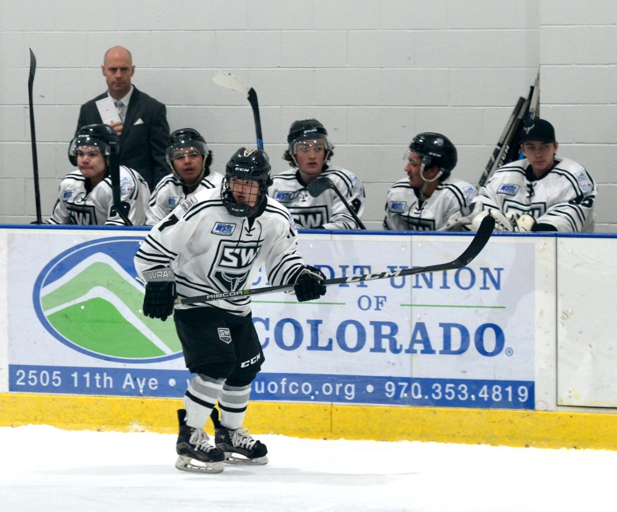 JJ Landers looks for the puck in the Steamboat Wranglers' game against the Colorado Junior Eagles Saturday, in Greeley.